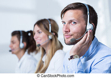 Support phone operators in headset - Close-up of support...
