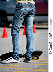 Street surfer girl - View of the legs of a young...
