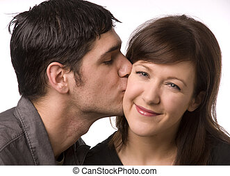 Cute kiss on cheek - Cute affectionate kiss on the cheek....