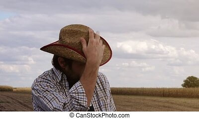 Concerned farmer planning new seeding season, male farmer...
