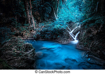 Mystery night at tropical forest with waterfall.....