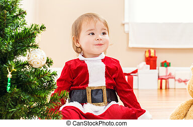 Little girl smiling on Christmas morning - Little toddler...