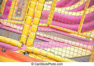 trampoline playground - padded protection surrounding an...