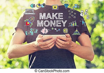 Make Money concept with young man holding his smartphone...