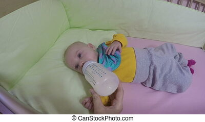 baby drink milk bottle - Closeup of baby drink milk powder...