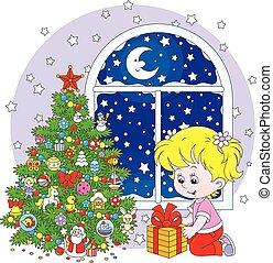 Girl and Christmas gift - The Christmas night, a little girl...