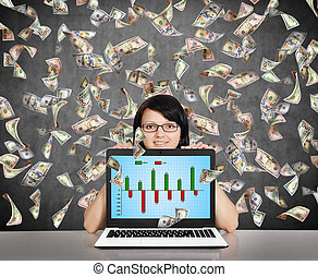 businesswoman holding laptop with business chart and falling...