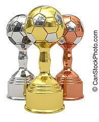 Golden, silver and bronze soccer trophies on white...