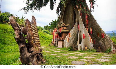 view of giant tree decorated traditionally with red strips