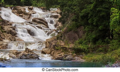 cascade of waterfalls on mountain stream in tropical park -...