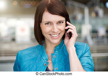 Older woman smiling when talking on mobile phone