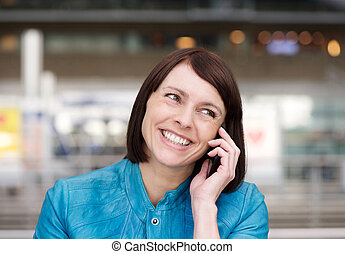 Older woman smiling when talking on cell phone