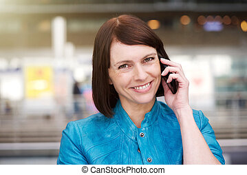 Mature woman smiling when talking on mobile phone