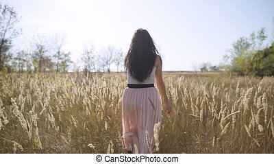 Cute girl flees field slow motion - Cute girl flees field...