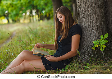 a woman of European appearance twenty years reading a book...