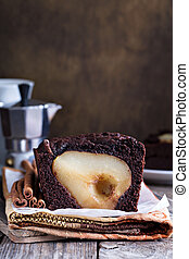 Chocolate cake with pears baked inside