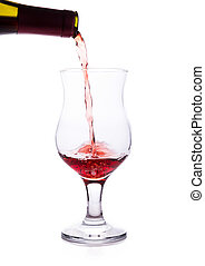 Clear glass and a bottle of red wine