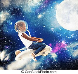 Little girl astronaut - Little girl with toy airplane in...