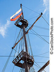 Russian flag flutters on a mast sailing vessel on a...
