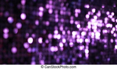 Sequins violet sparkling reflective background.