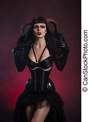 Sexy female demon in fetish costume - Sexy female demon in...