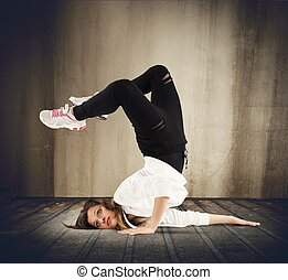 Breakdance girl - Agile dancer in a pose of breakdance