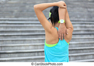 fitness woman runner stretching outdoor