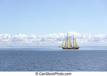 Tall Ship. - Sailing ship in the open blue sea.