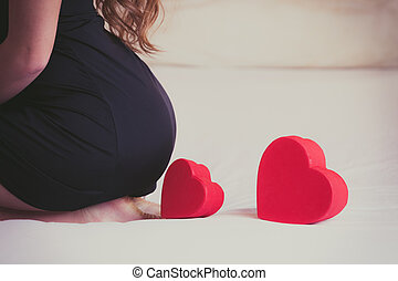 Closeup of heart shape box and woman ass buttocks.