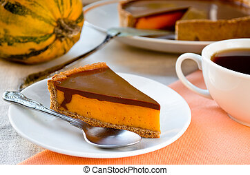 Homemade pumpkin pie with chocolate topping. Piece on plate.