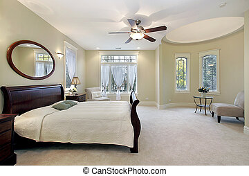Master bedroom in luxury home with sitting area