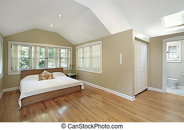 Master bedroom with skylight - Master bedroom with recessed...