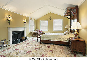 Master bedroom with gold walls - Master bedroom with sconces...