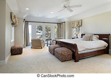 Luxury master bedroom with lake view