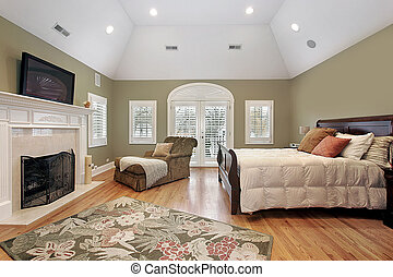 Master bedroom in luxury home with recessed ceiling