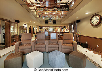 Theater room with sofas in luxury home