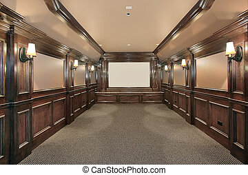 Home theater with wood paneled walls