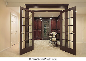 Wine cellar with sitting area - Entrance to wine cellar with...