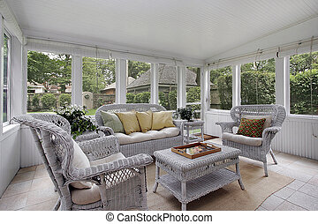 Porch with wicker furniture - Porch in luxury home with...