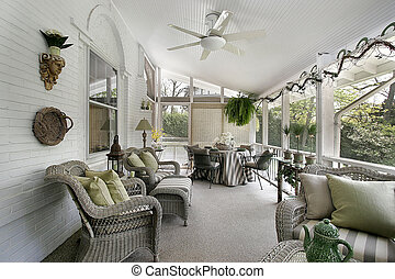 Porch with wicker furniture - Screen-in porch with wicker...