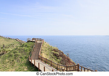 View of Olle walking path No. 10 Course in Songaksan in jeju...