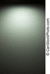 Spotlight on Wall - A spotlight shines on a painted textured...