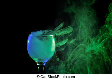 Blue and green smoke in a glass. Halloween. - Abstract art....