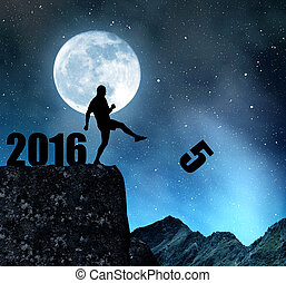 Concept New Year 2016 - Silhouette of man kicked to fives....