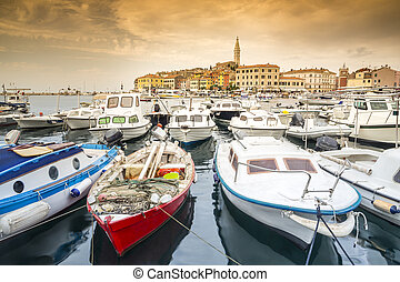Croatian coast - boats and historic town of Rovinj