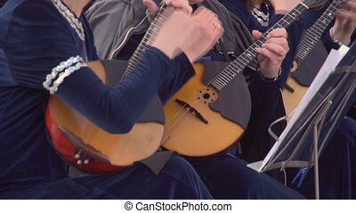 Playing the two lutes - Girils are playing the lute