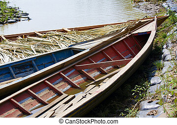 Boats parked at the bank of Manu River in Peru