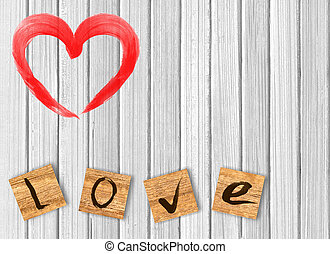heart on white wooden background. Love cast out of wooden...