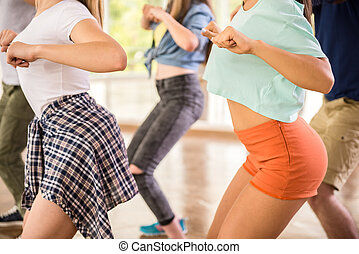 Dancing people - Young dancing people in gym during exercise...