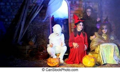 Little Witches And Ghost Singing Songs At Halloween - Three...